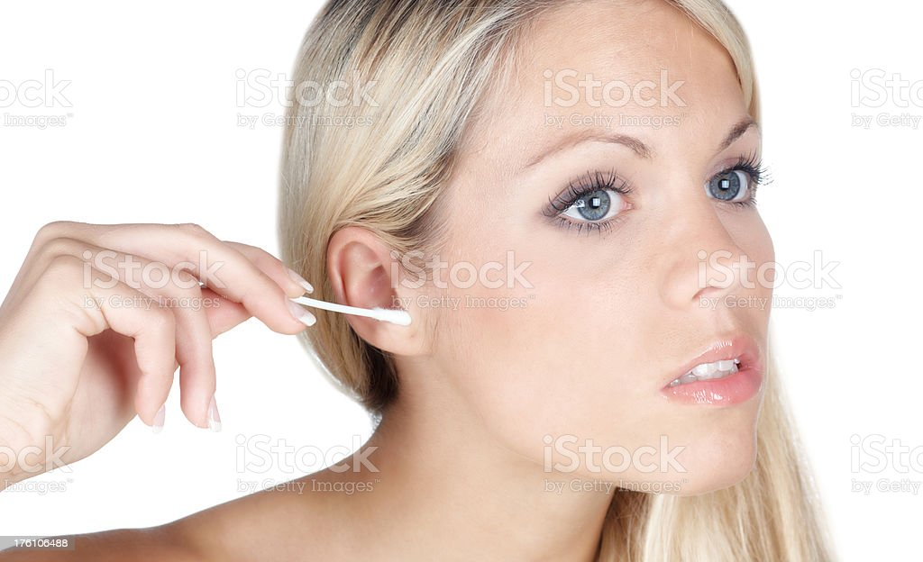 beautiful blonde woman cleaning her ears stock photo