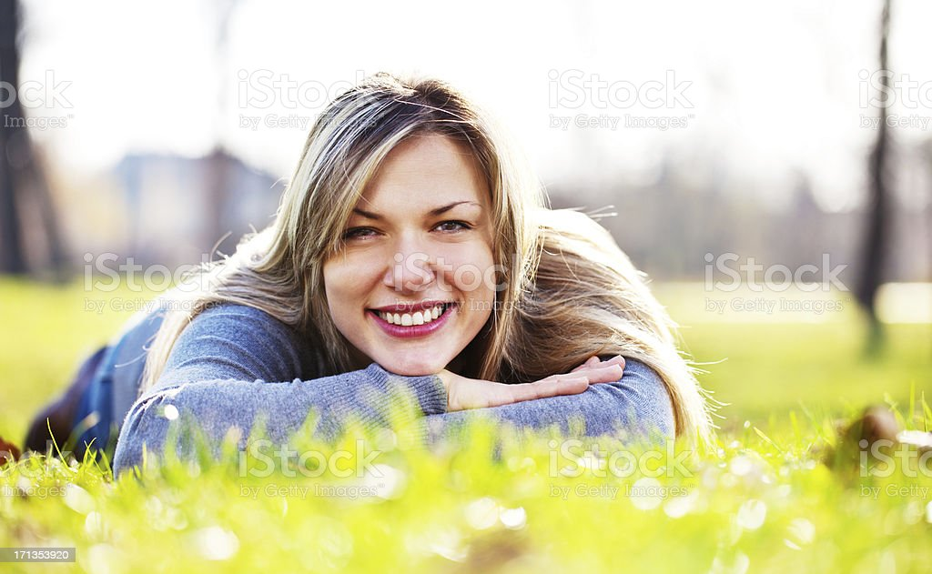 Beautiful blonde woman enjoying in the park. royalty-free stock photo