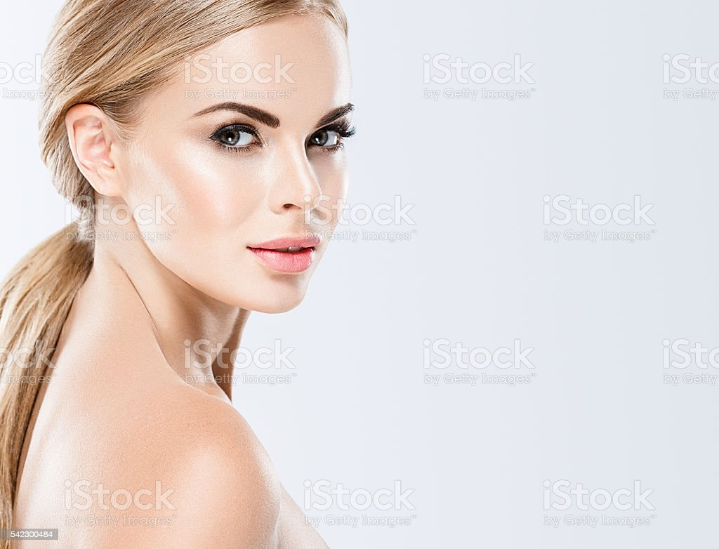 Beautiful blonde woman face close up portrait studio on white stock photo