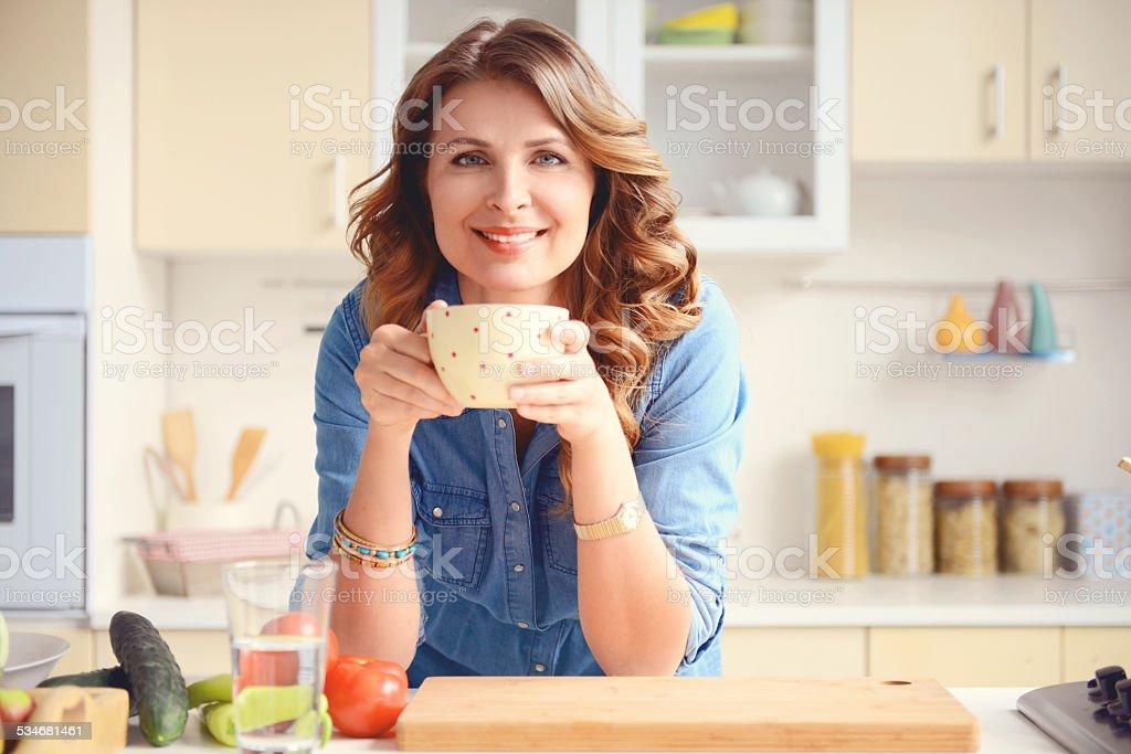 beautiful blonde woman in the modern kitchen stock photo