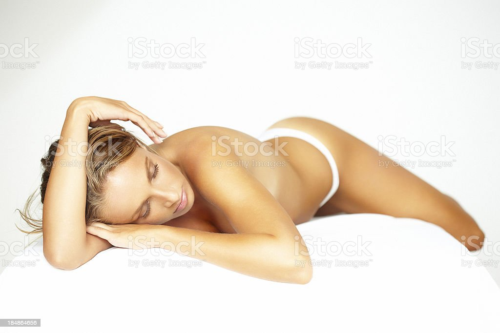 Beautiful, blonde woman lying on bed, waiting for spa treatment royalty-free stock photo