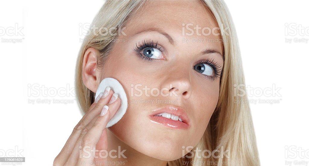 beautiful blonde woman removing make-up royalty-free stock photo