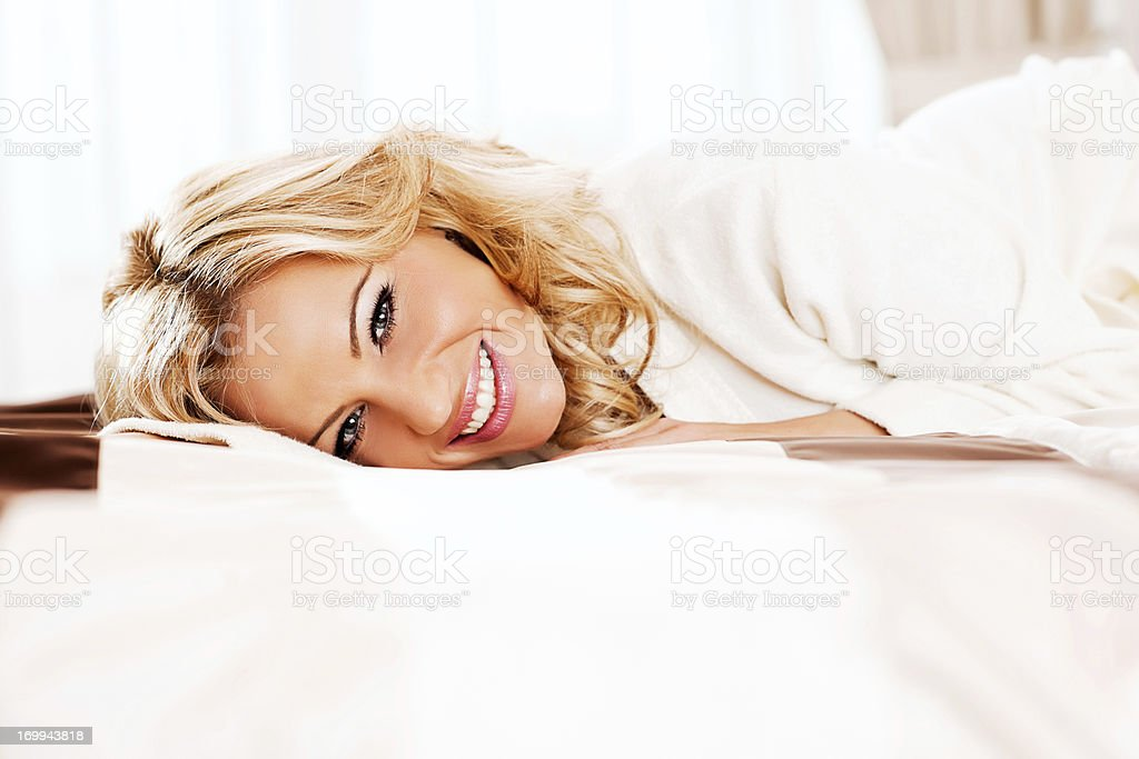 Beautiful blonde woman resting in the hotel room. royalty-free stock photo