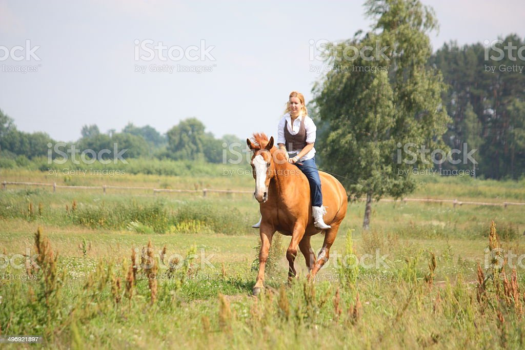 Beautiful blonde woman riding horse bareback royalty-free stock photo