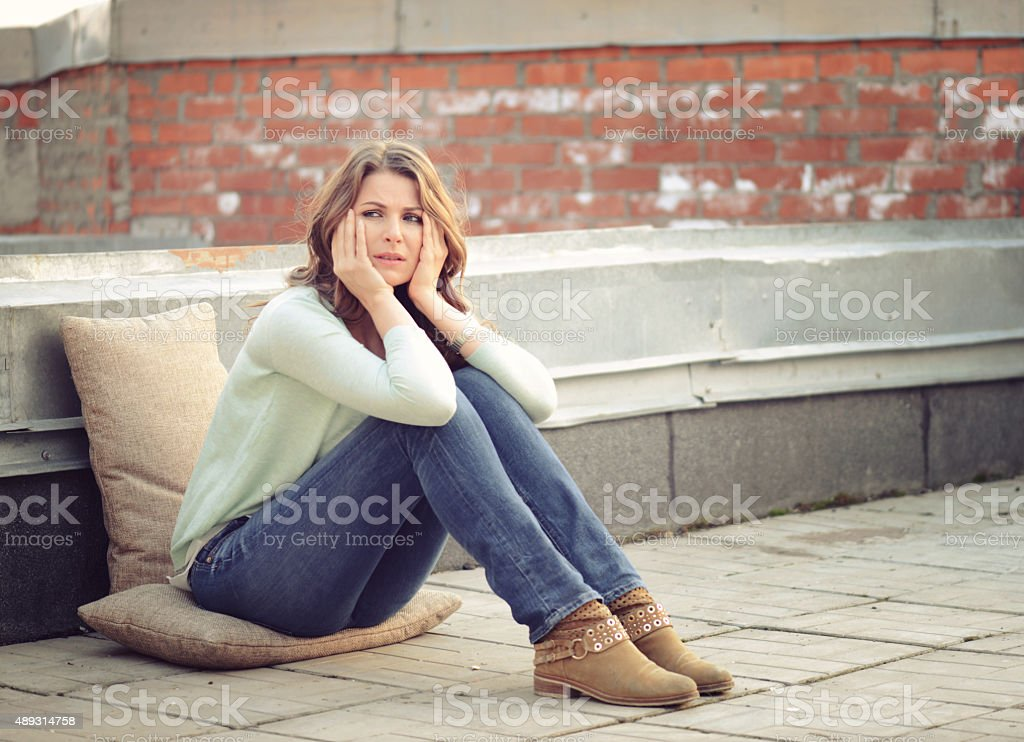 beautiful blonde woman sad stock photo
