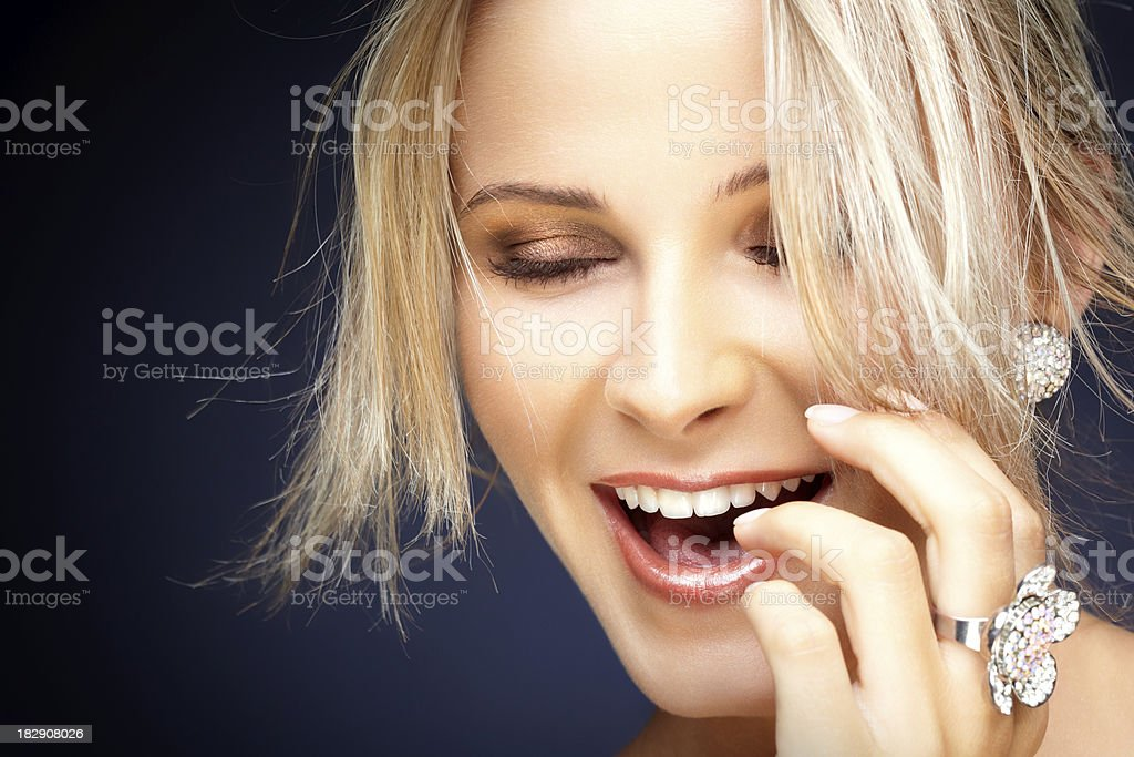 Beautiful blonde woman smiling royalty-free stock photo