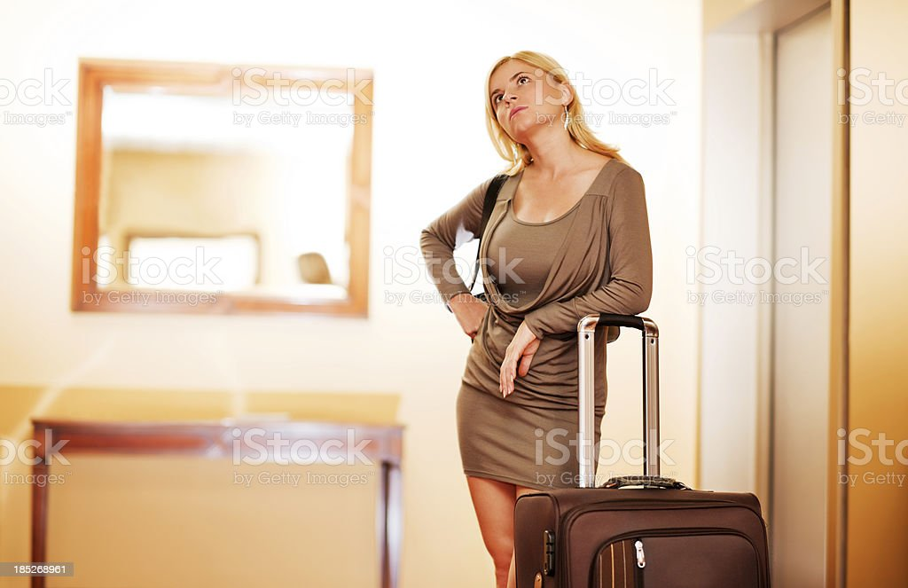 Beautiful blonde woman waiting for the elevator. royalty-free stock photo