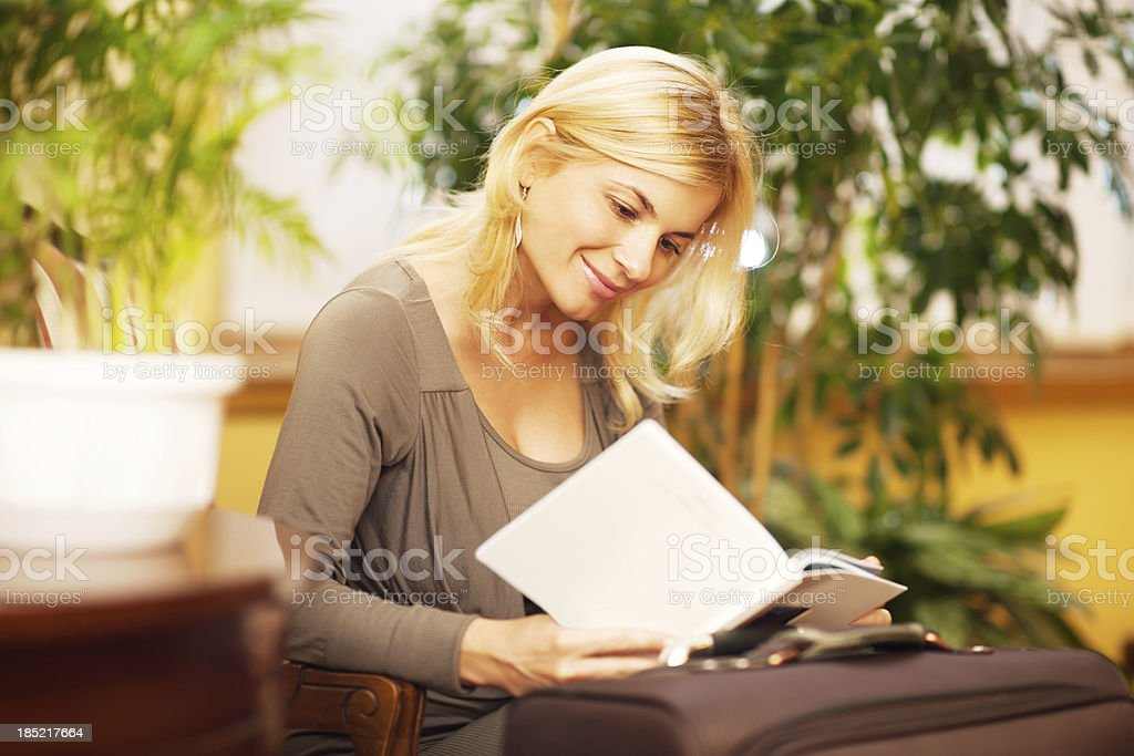 Beautiful blonde woman waiting in a lobby. royalty-free stock photo