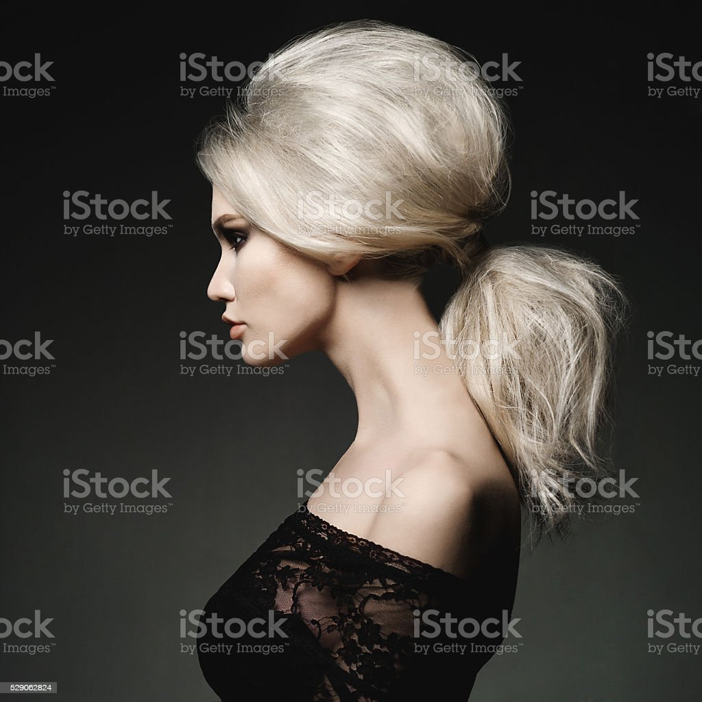 Beautiful blonde woman with elegant hairstyle stock photo