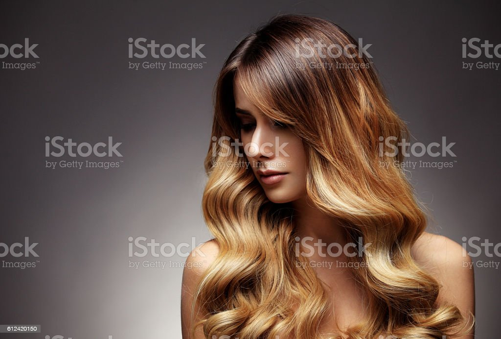 Beautiful blonde woman with long, healthy , straight and shiny hair. stock photo