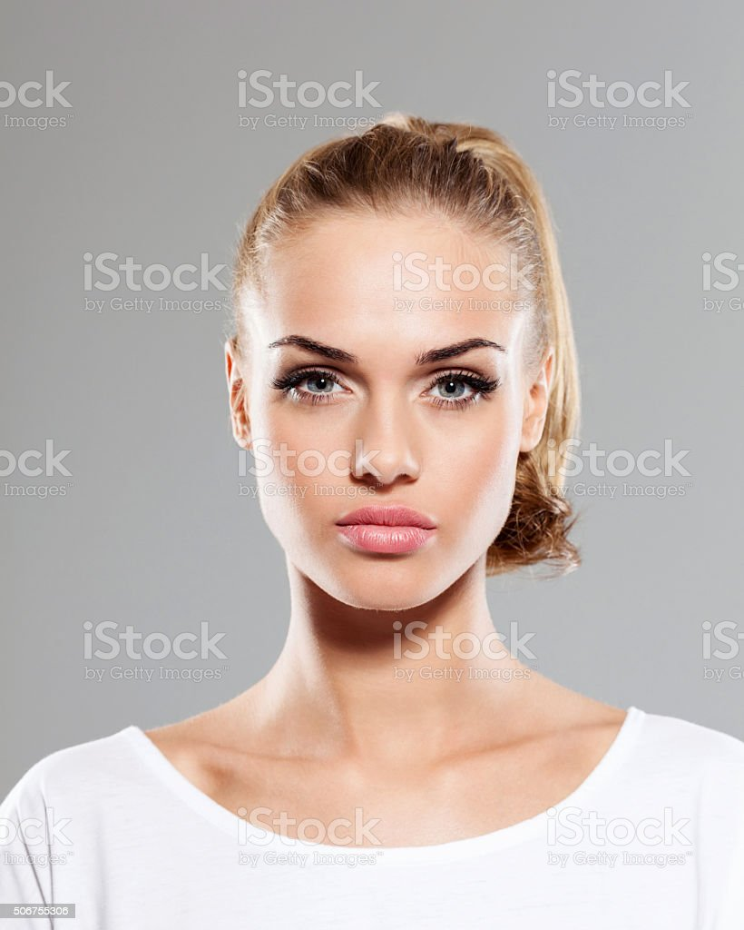 Beautiful blonde young woman, close up of face stock photo
