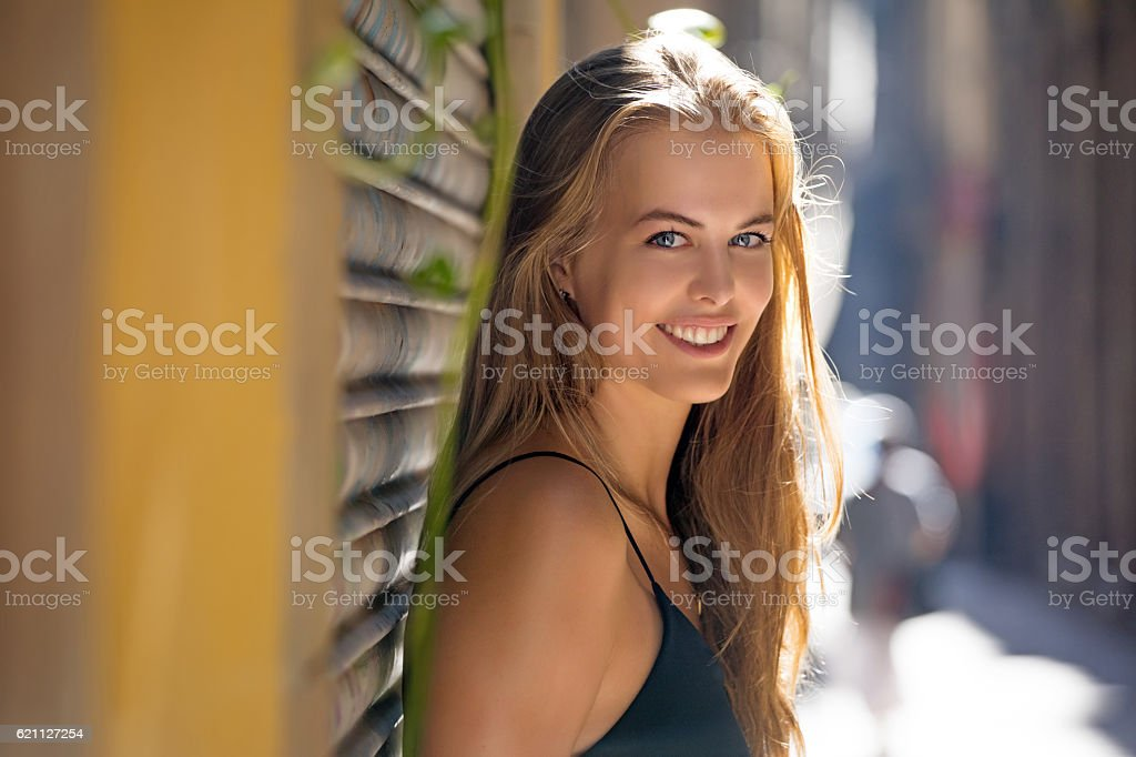 Beautiful blonde young woman posing for portrait on sunny day stock photo