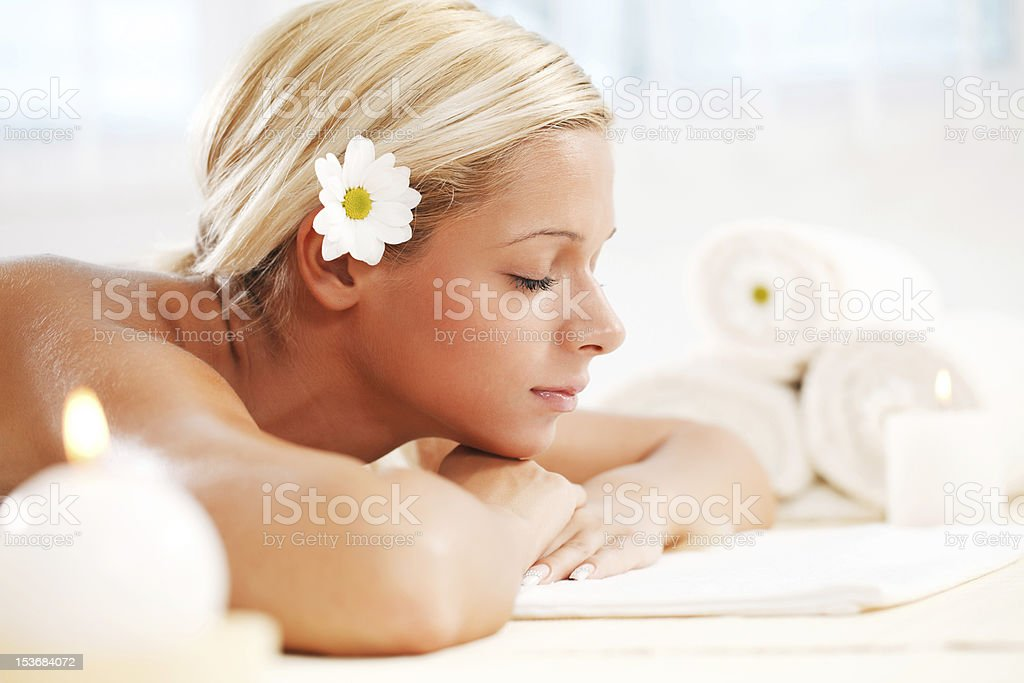 Beautiful blonde young woman relaxing at the spa centre. royalty-free stock photo
