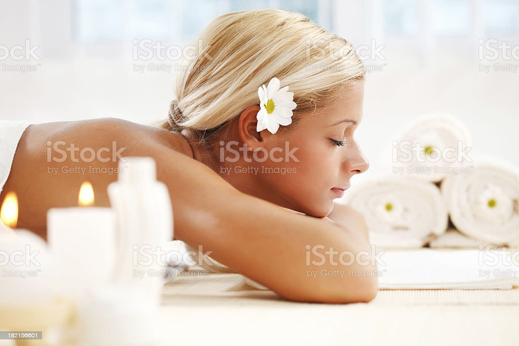 Beautiful blonde young woman relaxing at the spa centre royalty-free stock photo