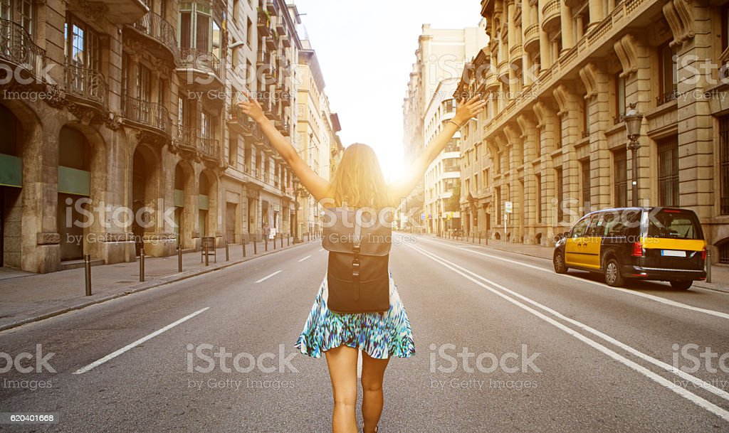Beautiful blonde young woman student enjoying freedom in new city stock photo