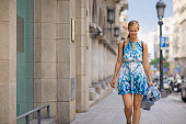 Beautiful blonde young woman tourist exploring life in new city
