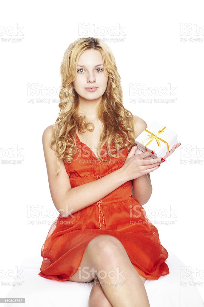 Beautiful blonde young woman with gift box royalty-free stock photo
