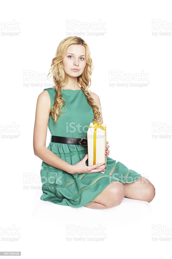 Beautiful blonde young woman with gift box. royalty-free stock photo