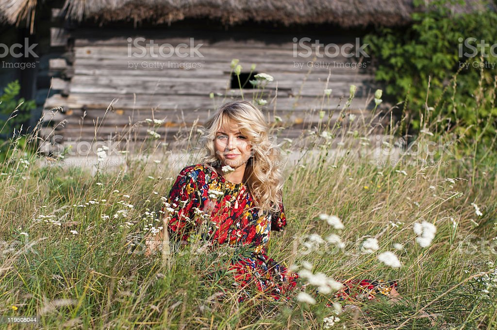 Beautiful blondie in the village stock photo