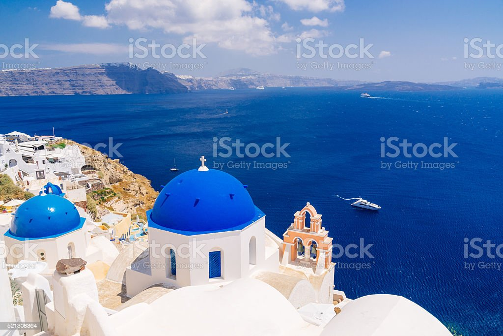 Beautiful blue dome churches in Oia, Santorini stock photo