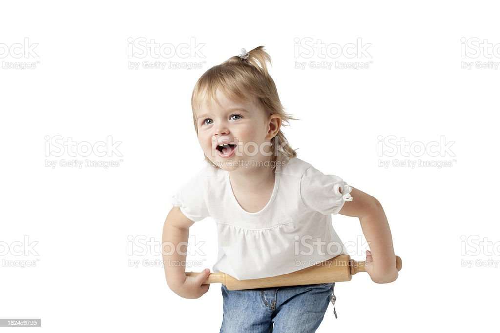 Beautiful blue eyed little girl with rolling pin stock photo