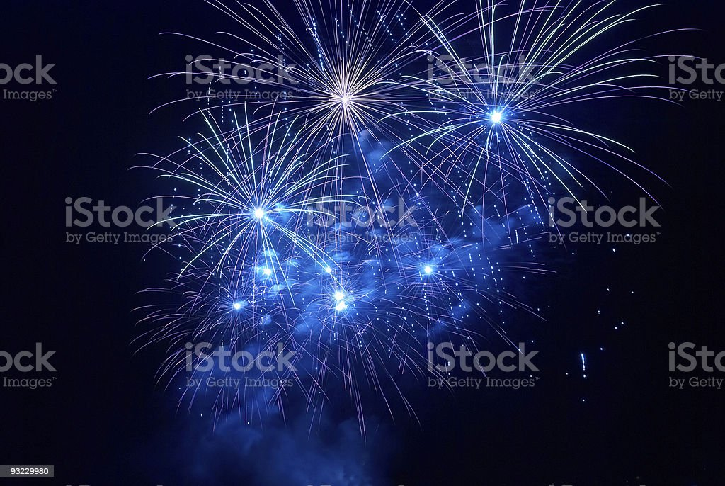 Beautiful blue fireworks in the night sky royalty-free stock photo