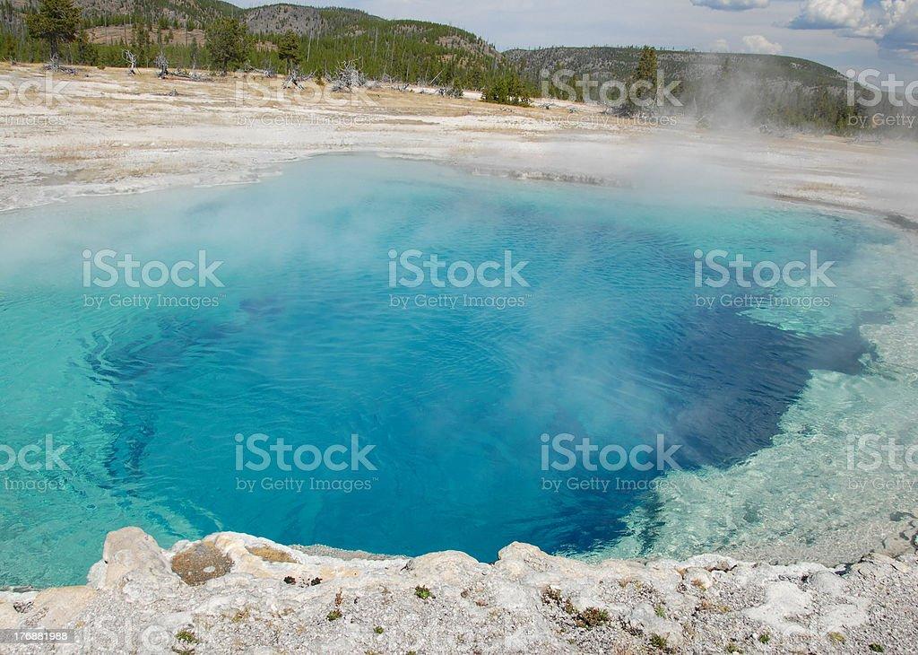Beautiful blue hue adorns Sapphire Pool in Yellowstone stock photo