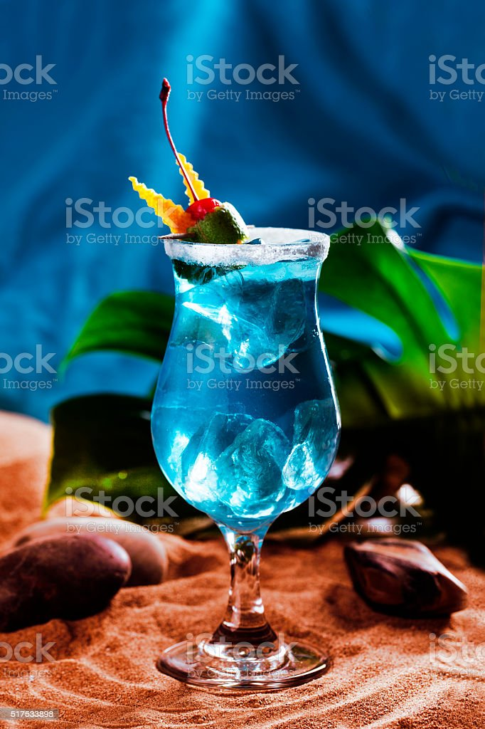 beautiful blue lagoon cocktail with ice in a still life stock photo