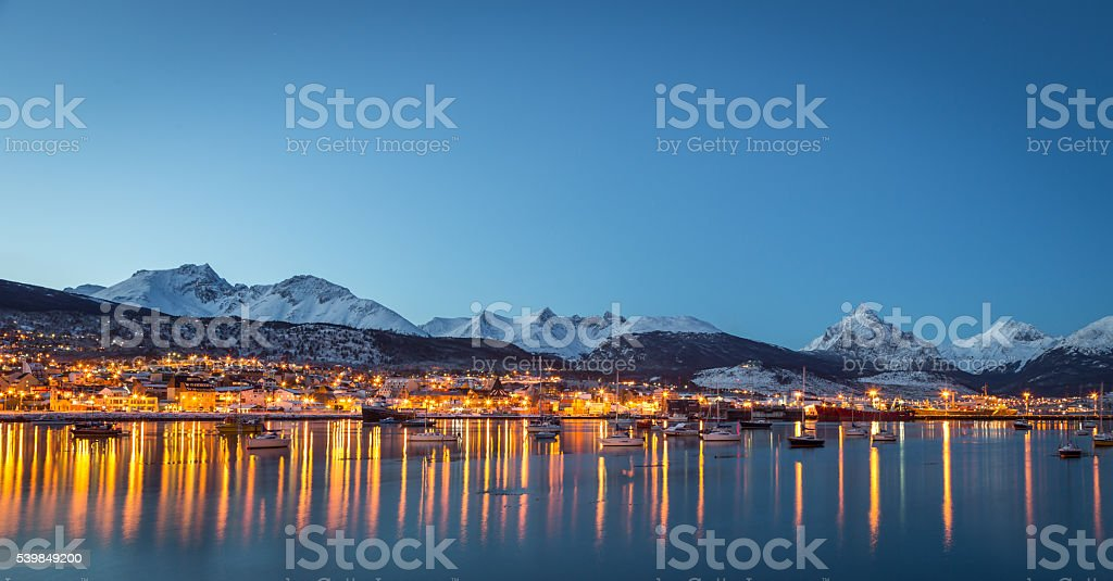 Beautiful blue lake with snowed mountain in the background stock photo