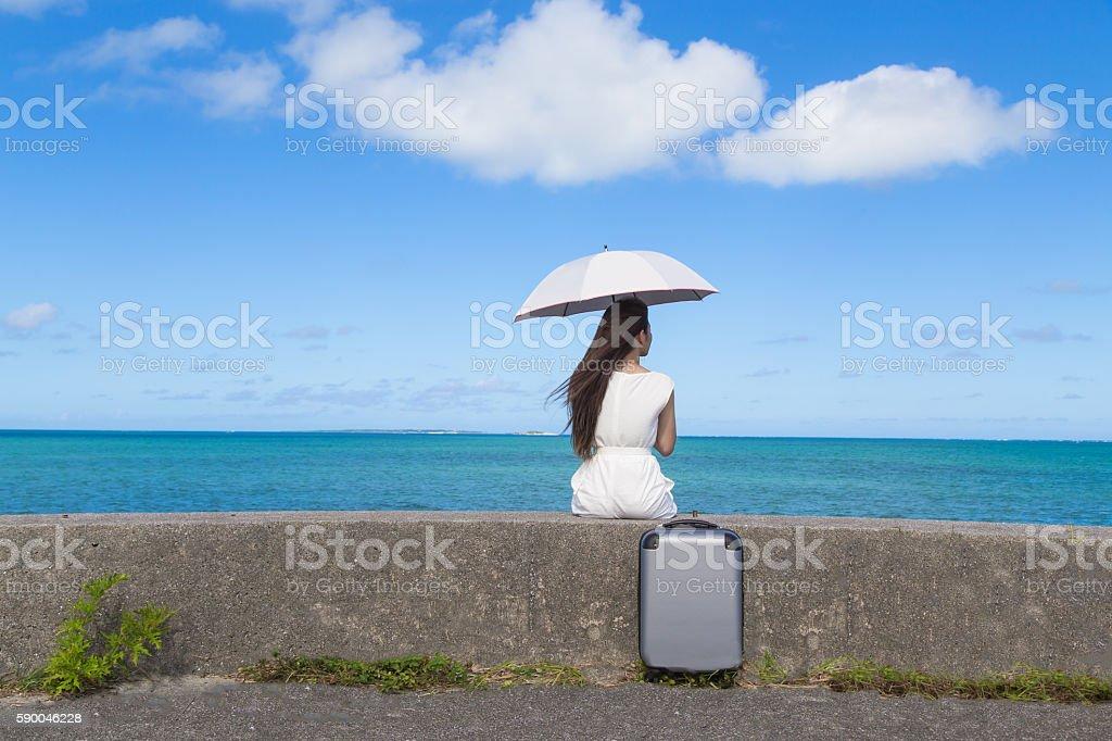 Beautiful blue sea and young women stock photo