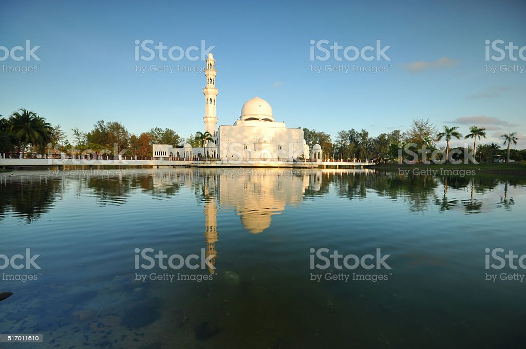Beautiful blue sky over Tengku Tengah Zaharah Mosque. stock photo