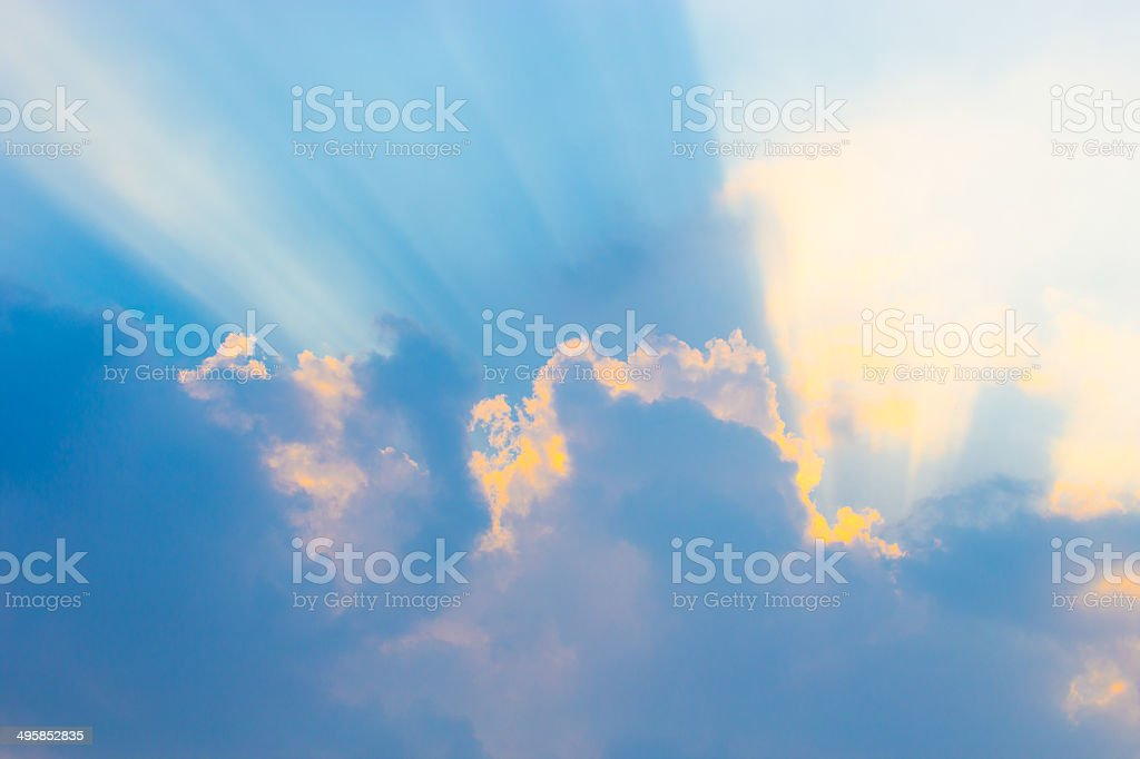 Beautiful blue sky with sunbeams and clouds. Sun rays. stock photo