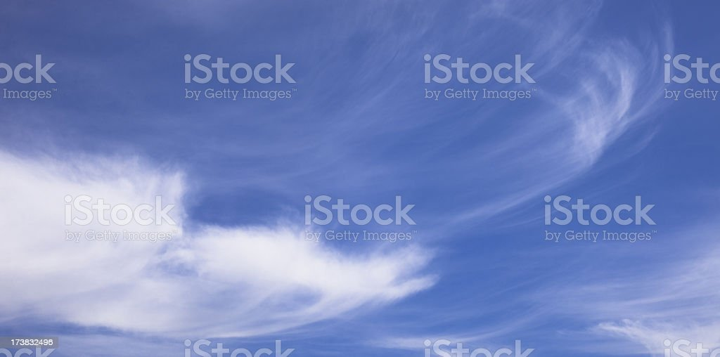 Beautiful blue sky with white wispy clouds royalty-free stock photo