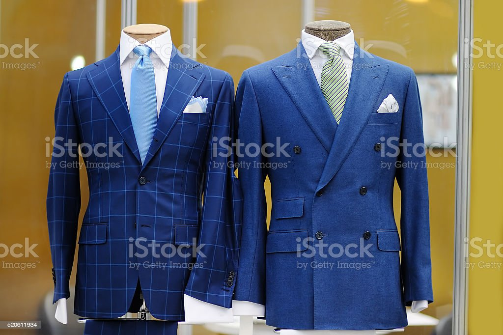Beautiful blue suits on a mannequin stock photo