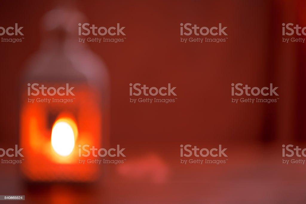 Beautiful blurred background with a glowing lantern. stock photo