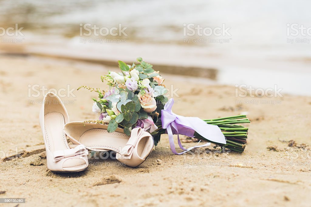 Beautiful boho composition with a bridal bouquet and wedding shoes stock photo