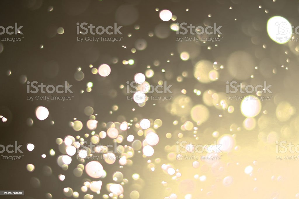 Beautiful bokeh and blurry on a gold background. stock photo
