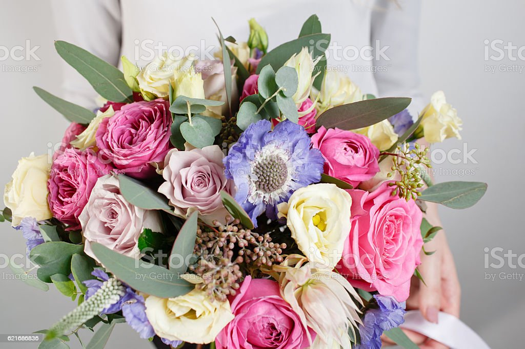beautiful bouquet made of different flowers with in woman hand stock photo