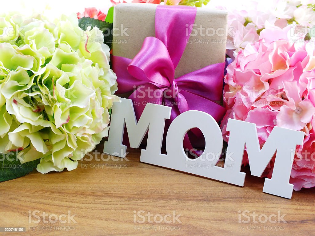 beautiful bouquet of flowers and gift for mother s day stock photo