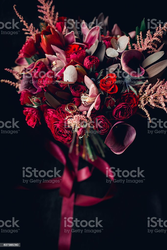 Beautiful bouquet of flowers with wedding rings stock photo