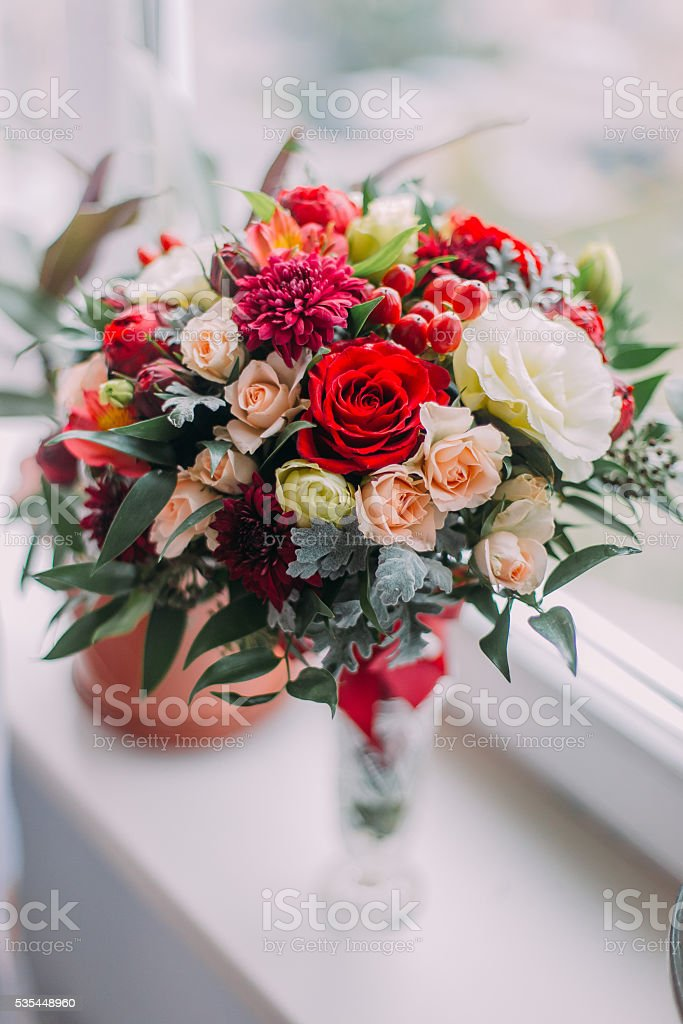 Beautiful bouquet of red, white and pale pink roses in stock photo
