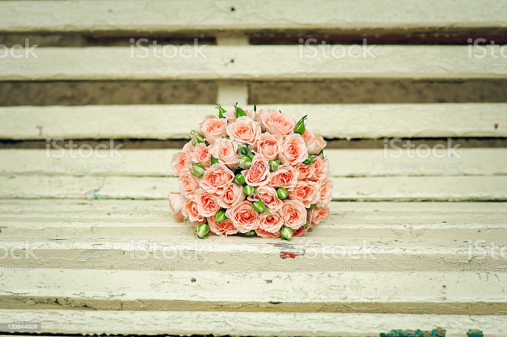 beautiful bouquet of roses lie on a bench royalty-free stock photo