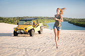 Beautiful Brazil, Female Tourist with Sand Buggy, Dunes, Icarai