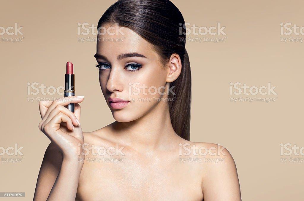 Beautiful Brazilian woman beige colored pomade stock photo
