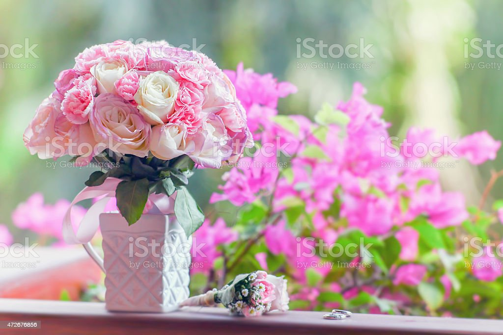 beautiful bridal bouquet of roses on a green background stock photo