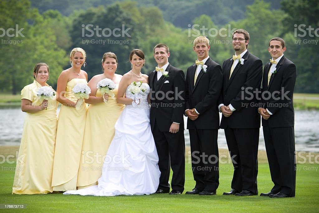 Beautiful Bridal Party Portrait -- Outdoors with Lake Background stock photo
