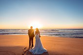 Beautiful bride and groom at the beach