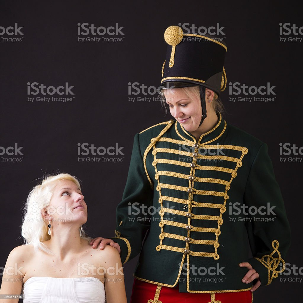 beautiful bride and hussar stock photo