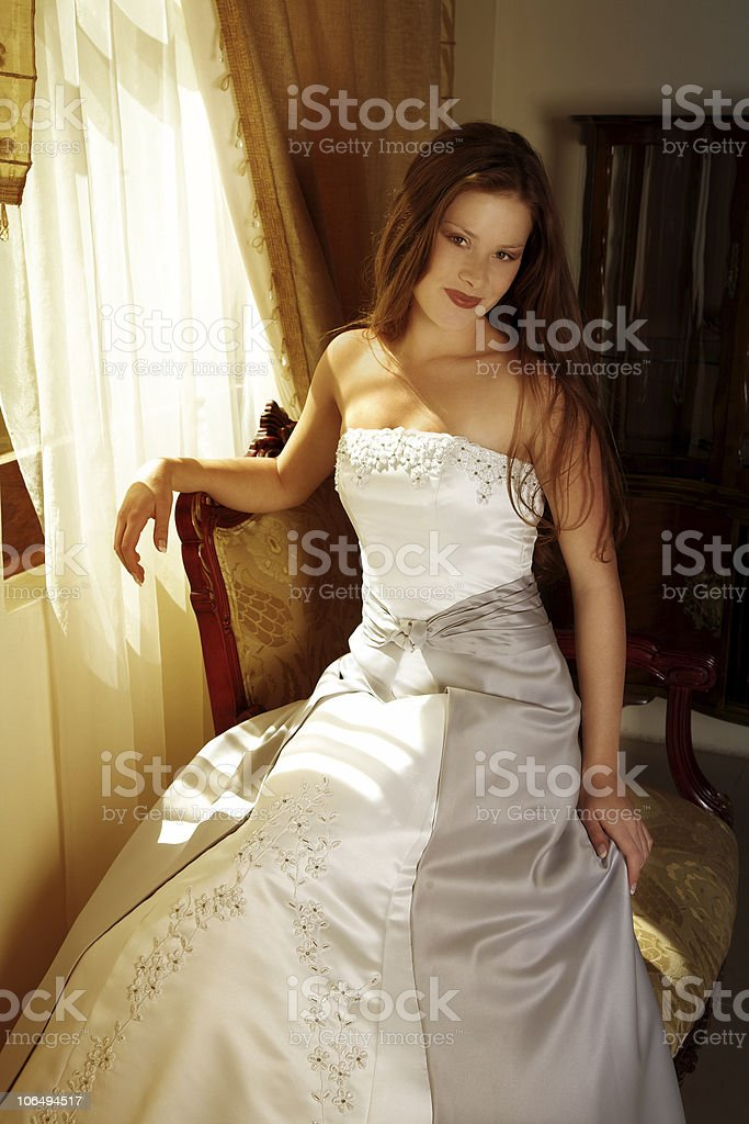 Beautiful bride at the window royalty-free stock photo