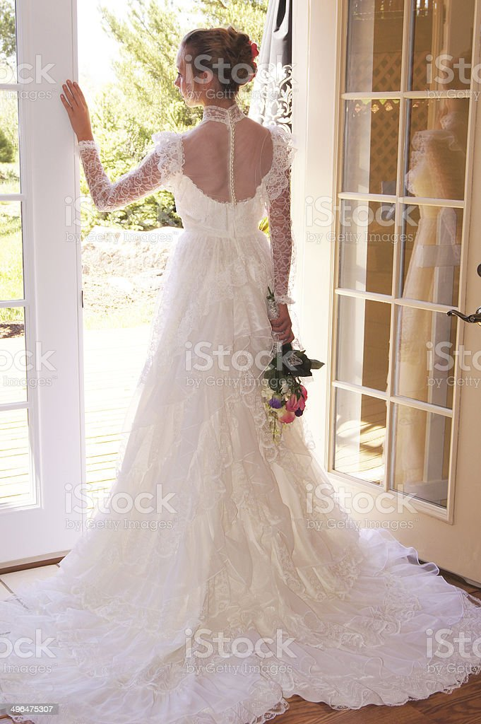 Beautiful Bride By French Doors stock photo